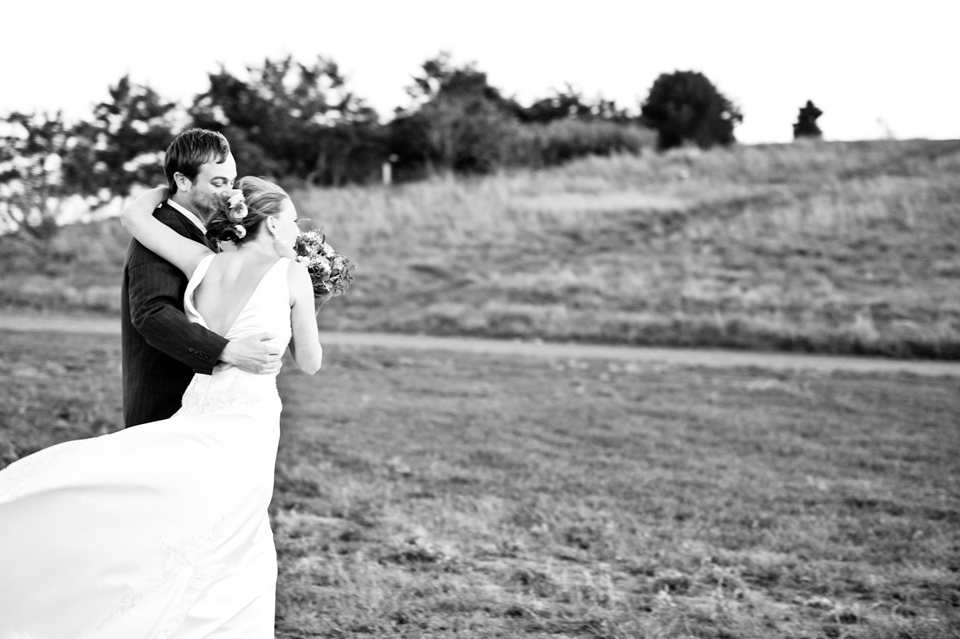 bride and groom on hill