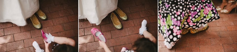 little girl trying on bride's shoes