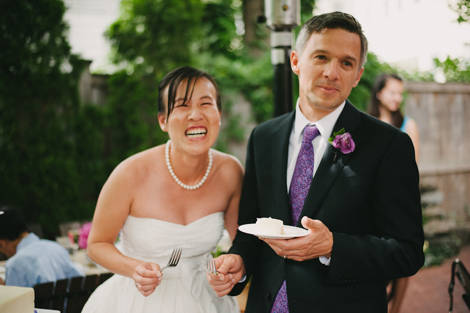 couple eating oleana wedding cake