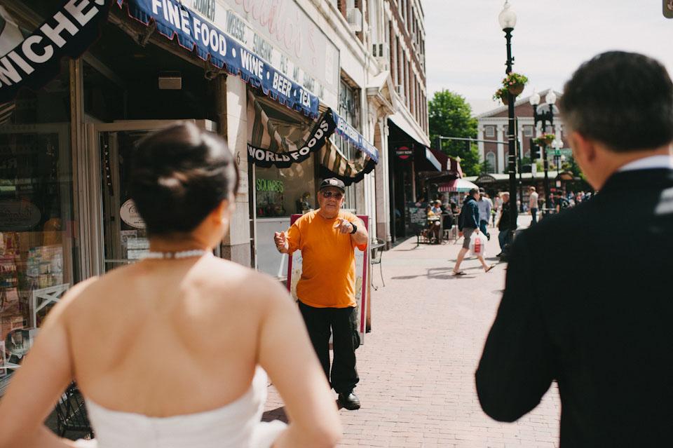 bride and groom walking around harvard sq