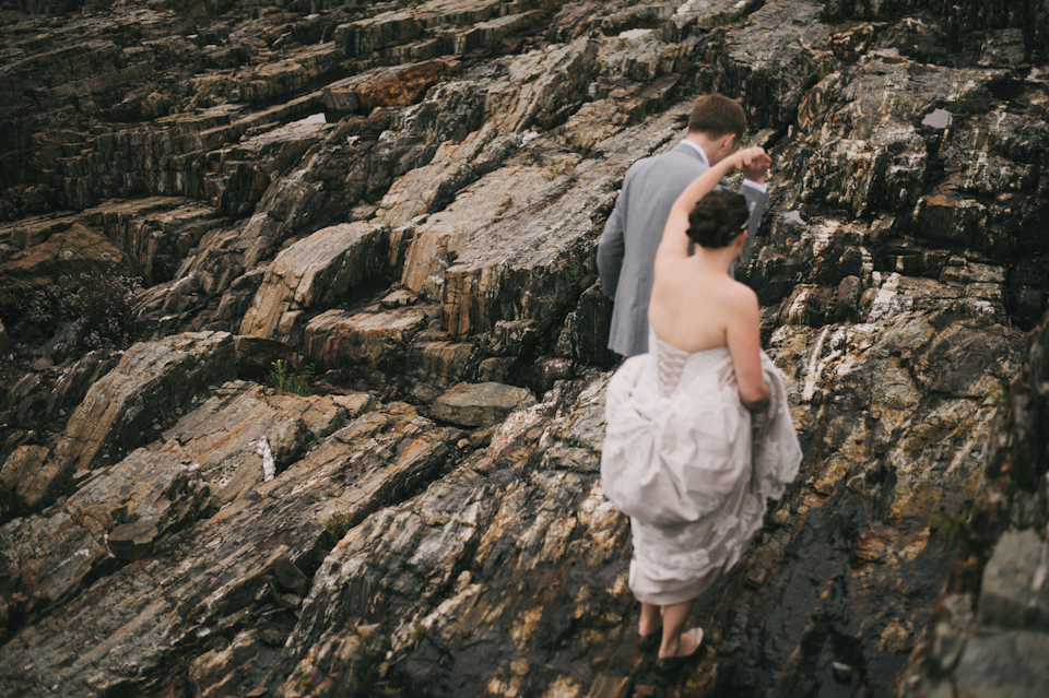 bride and groom on rocky maine coast