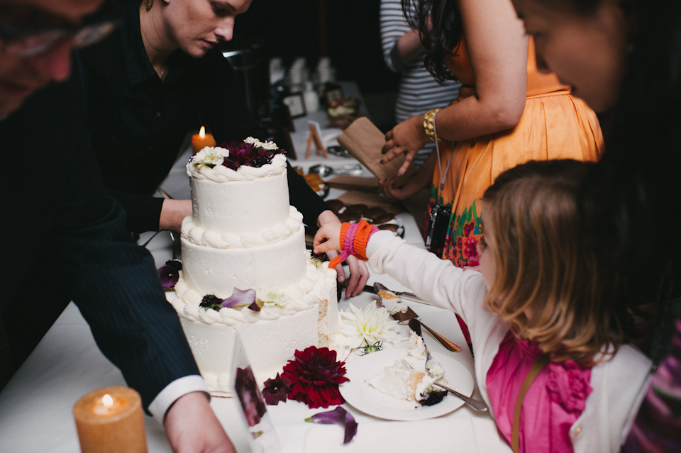 little girl trying to pick off cake