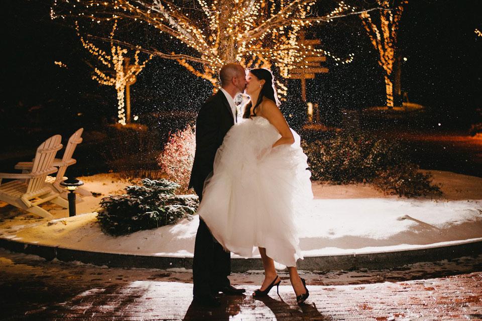 snowy church landing wedding portrait