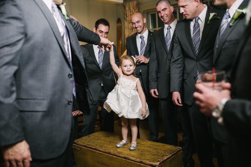 flower girl with groomsmen