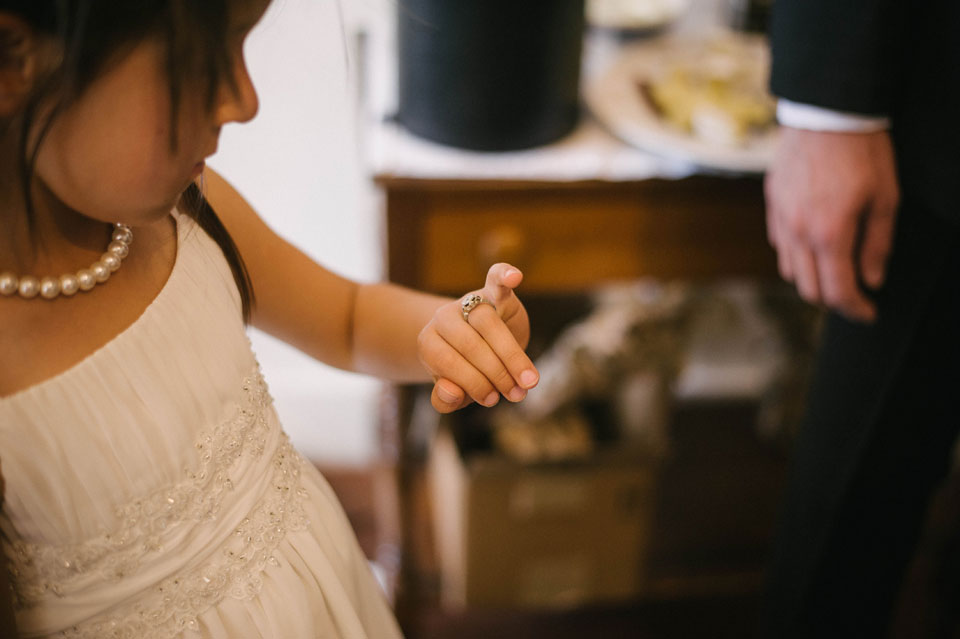 flower girl looking at old ring