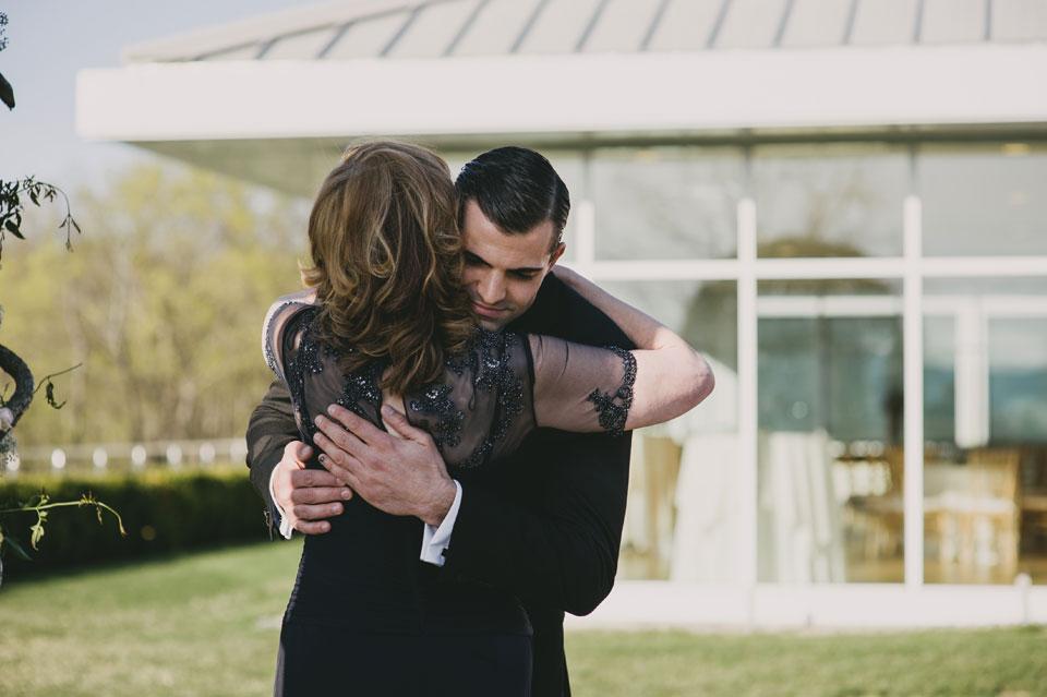 groom hugging mama
