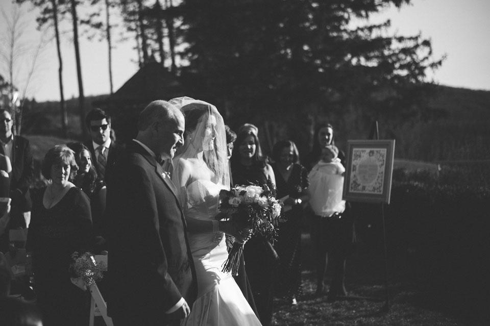 veiled bride walking down the aisle