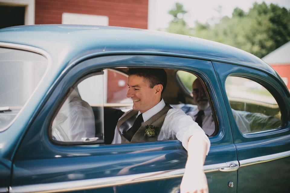 groom driving antique car