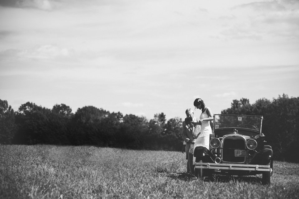 bride getting out of antique car with father