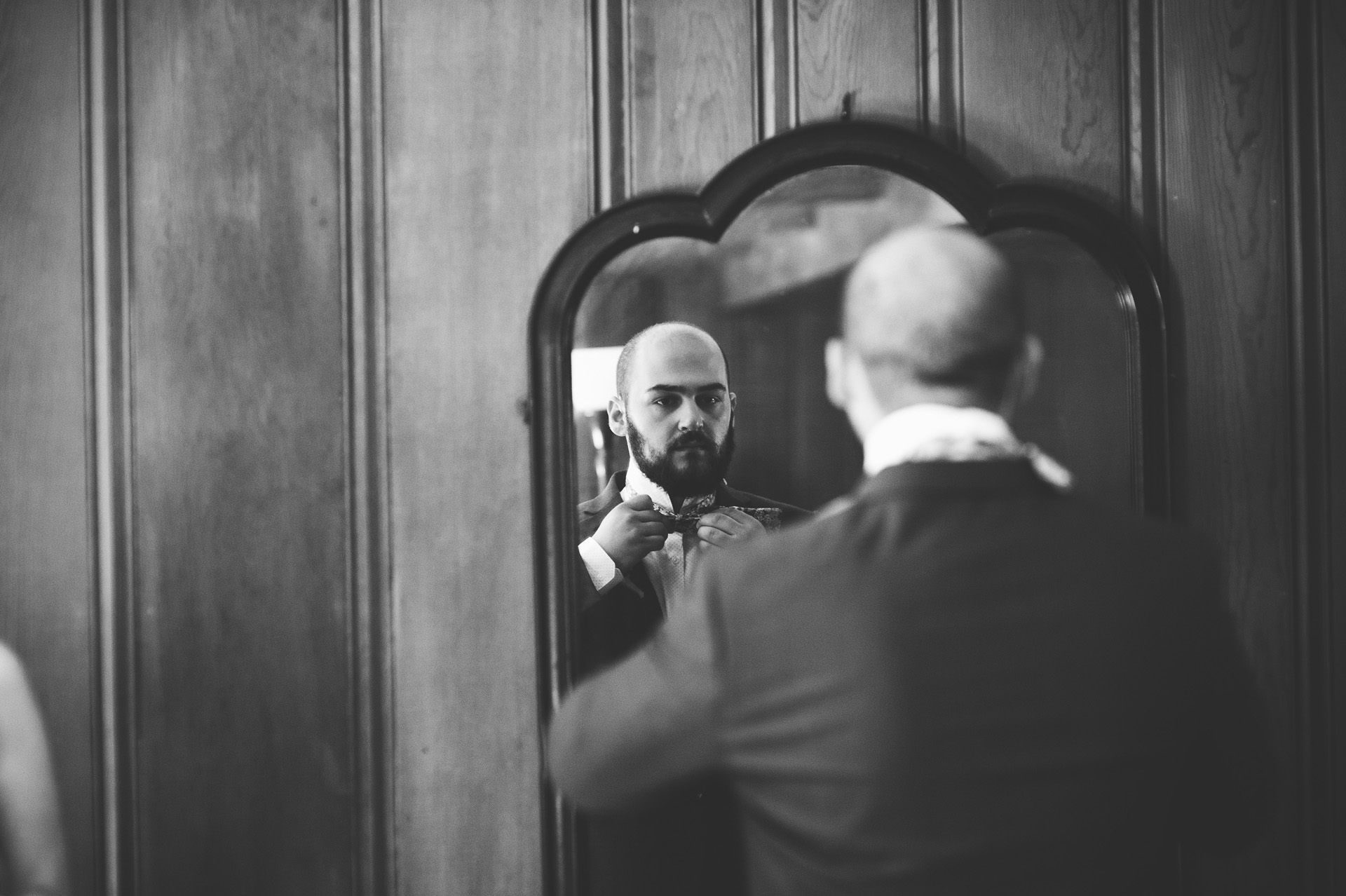 groom getting ready at the overbrook house